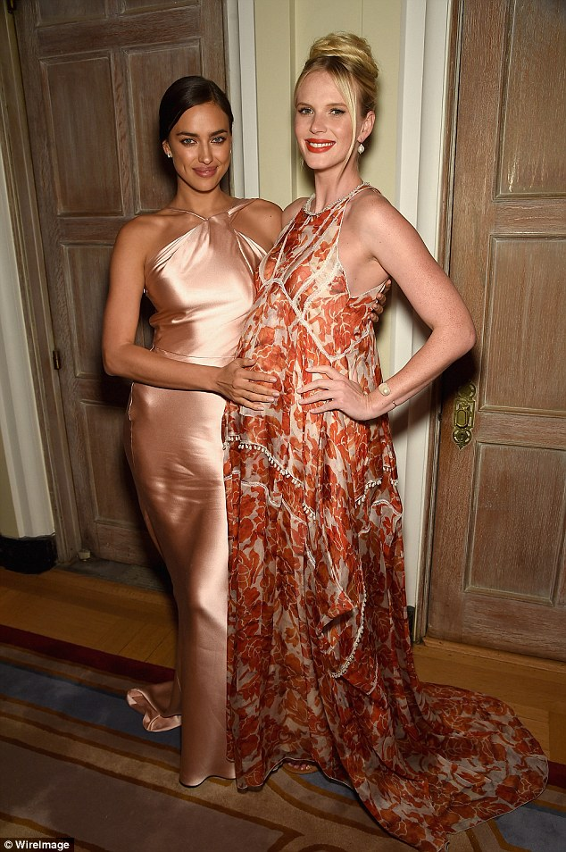 Firm friends: Anne V had her bump caressed by fellow model Irina Shayk at the Bloomberg and Vanity Fair cocktail reception on Saturday evening