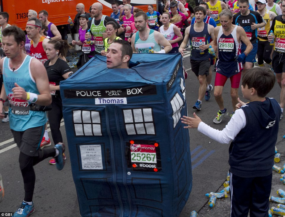 One runner, pictured at the 10-mile mark, chose to dress as a police call box as he made his way around the 26.2-mile marathon course