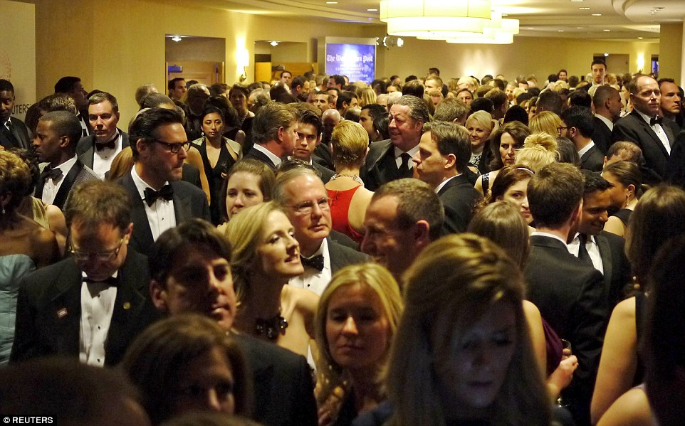Busy: Guests crowd into the hallways as they leave their pre-parties to go to the ballroom for the White House Correspondents' Dinner