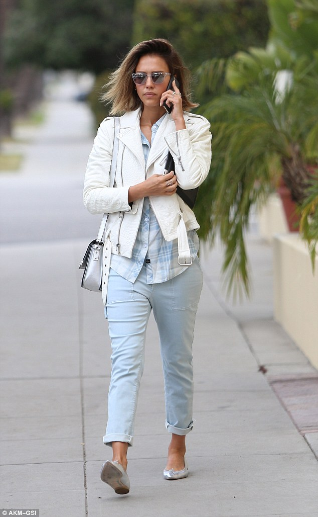 Pretty: Despite the grey skies, she picked a spring-like hue - teaming up a white leather jacket with pale blue cropped trousers ahead of turning 34 on Tuesday