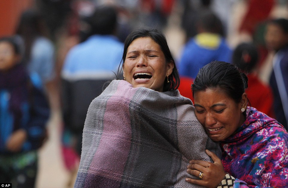 Women cry for loved ones killed in the disaster at a make-shift camp set up in a public park in Bhaktapur. Funeral pyres have been set up across the country in the streets