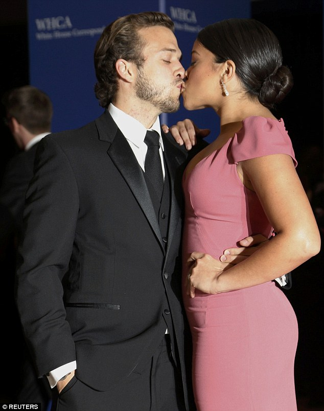 Sealed with a kiss! Gina Rodriguez and her boyfriend Henri Esteve shared a kiss at the White House Correspondents' Association Dinner as they made their way on the red carpet