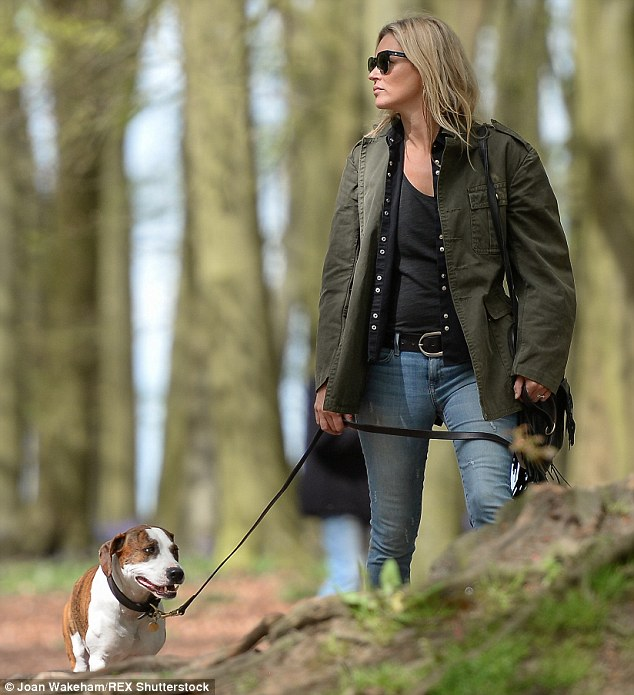 Addition to the family: The 41-year-old bought the dog in 2012 and seemed to revel in taking him for a walk