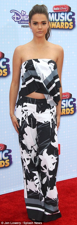Looking fly: The 21-year-old dressed her lean and slender frame in a black and white crop top and flared trousers