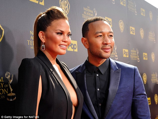 Dynamic duo! Chrissy wore her hair slicked back into a quiffed up-do, and accessorised with dramatic gem drop earrings