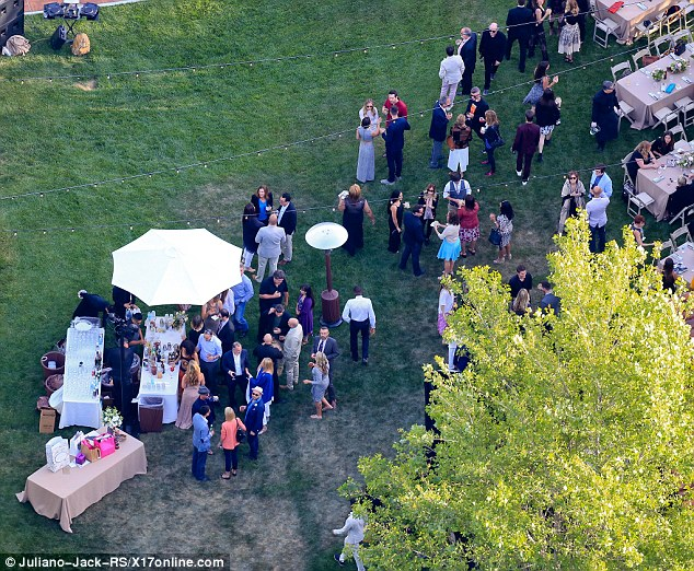 Keeping refreshed: Attendees treated themselves to a bar which was placed next to a large umbrella