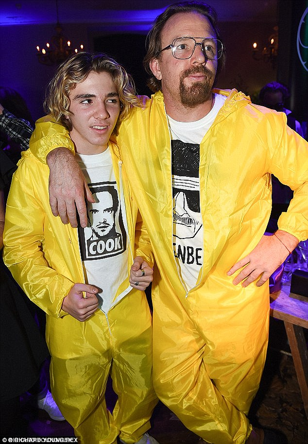 Guy Ritchie and his son Rocco don bright yellow hazmat lab suits to celebrate Halloween at London's Chiltern Firehouse last year