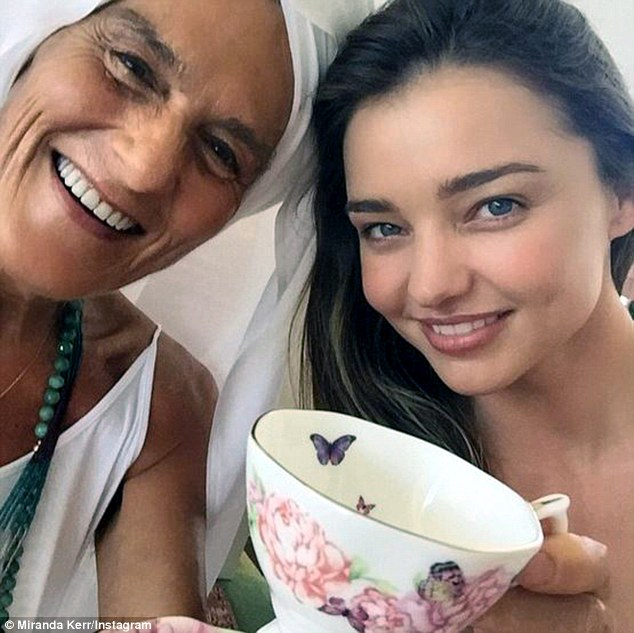 Does she ever age? Days after celebrating her 32nd birthday, Miranda Kerr (right) posted a selfie on Instagram alongside yogi Gurmukh (left) showing off her youthful looks