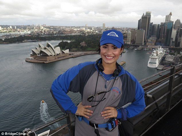 Touching tribute: Demi - pictured at the Sydney Harbour Bridge in April - dedicated a song to Bruce Jenner during her Auckland show