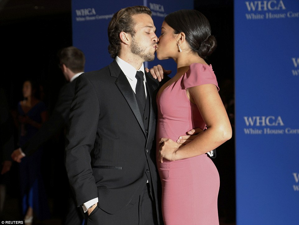 Couple: Gina Rodriguez, an award-winning actress, is pictured kissing her partner Henri Esteve following their arrival at the annual dinner