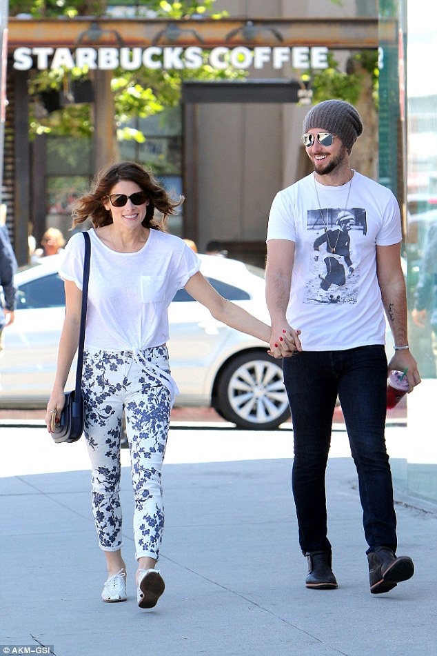 Day date: The loved-up couple, who have been dating for nearly two years, looked comfortable and relaxed as they walked through the warm sunny climes