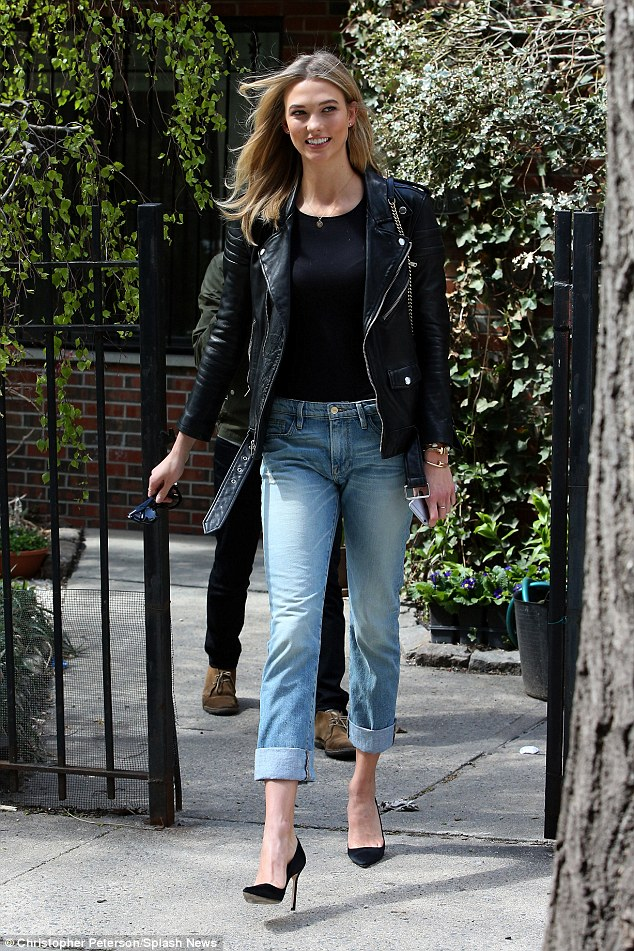 Classic cut: Karlie looked stunning as she wore a pair of her self-designed jeans for tall women as she returned home after a day of promotional activities at Bergdorf Goodman in New York on Friday