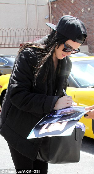 Friendly: Busy with her rehearsals, the daughter of Bruce Willis and Demi Moore still took time to sign autographs for fans