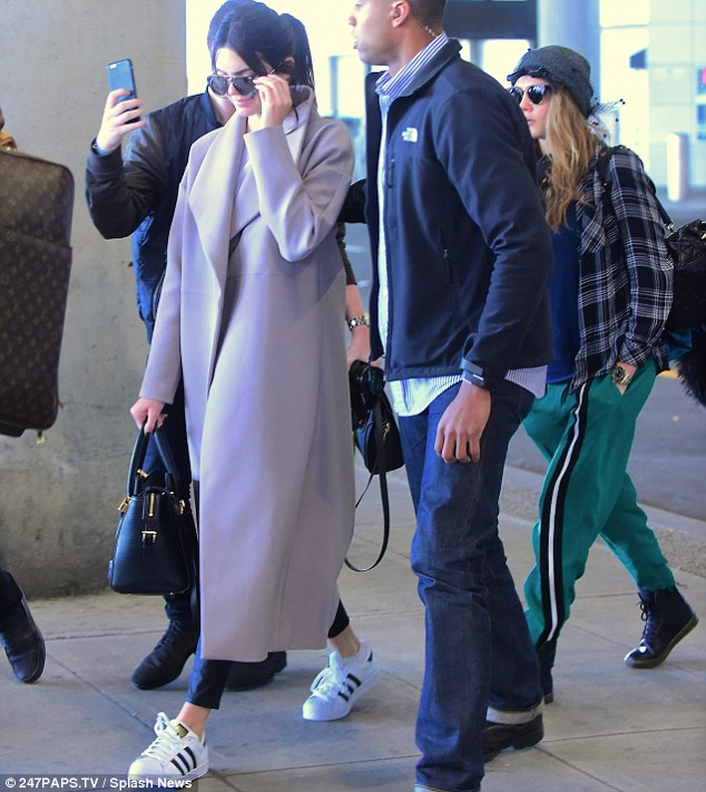 Big Apple: Kendall Jenner was spotted touching down at New York City's John F. Kennedy Airport with pal Cara Delevingne on Saturday