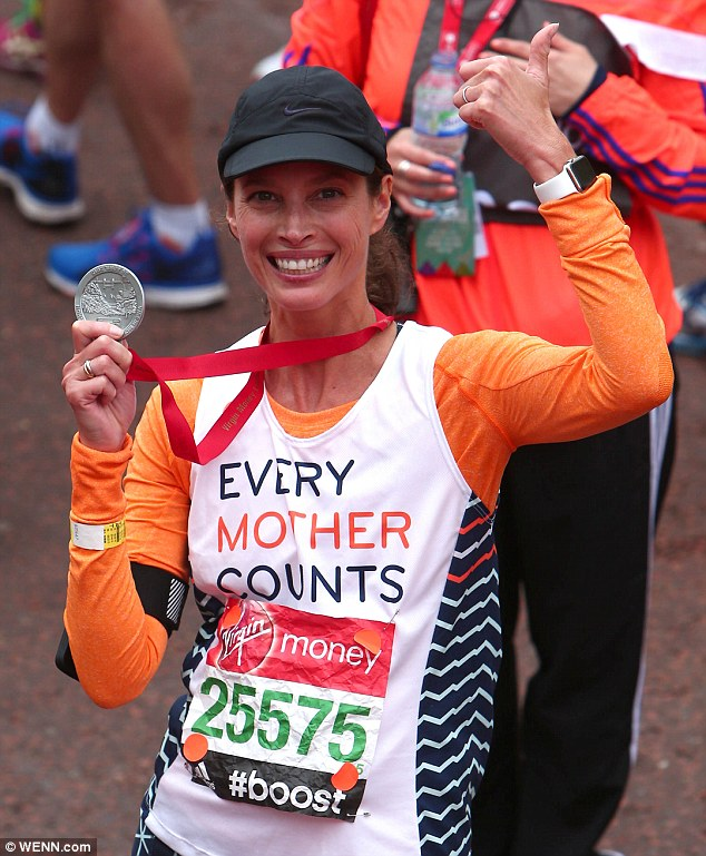 She did it! Christy flashed a huge smile as she crossed the finish line in the heart of London