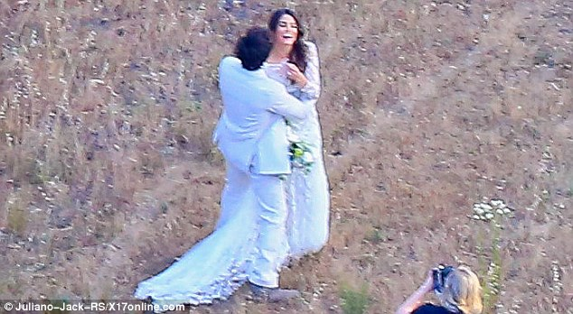 Saving the memory: The actress was pictured giggling away while a photographer captured the beautiful moment