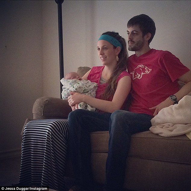 'Such a sweet little family!': On Saturday pregnant 19 Kids And Counting celebrity Jessa Seewald shared  this snap of her nephew Israel asleep in her sister's arms as she sat on a sofa with husband Derick, 25