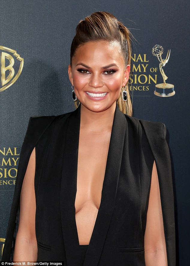 'Back in LA for the daytime emmy's!' Presenting with my fab team!' The half-Thai beauty highlighted her bronzed complexion with generous blush, nude lipstick, and a ponytail hair piece