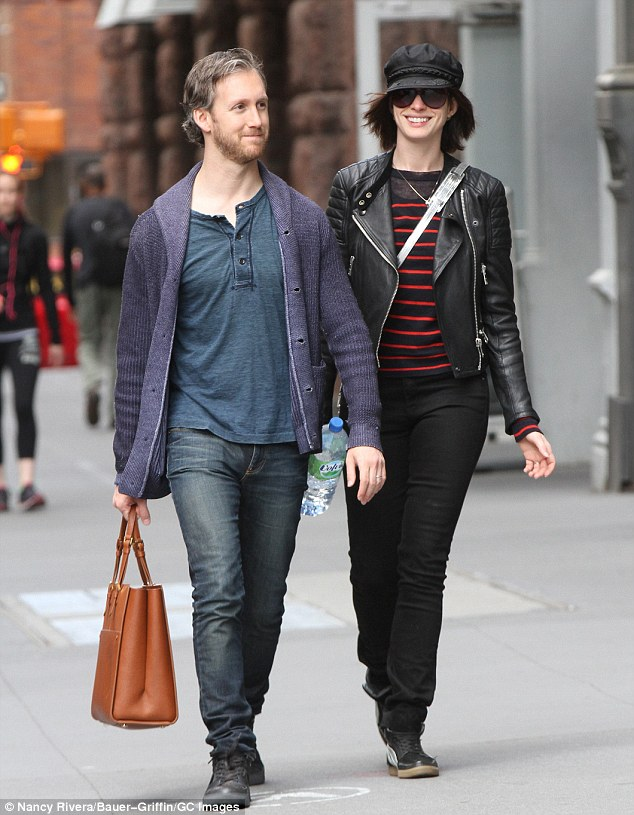The calm before the storm: Anne Hathaway took a sunny Manhattan stroll with her husband of two years Adam Shulman on Sunday