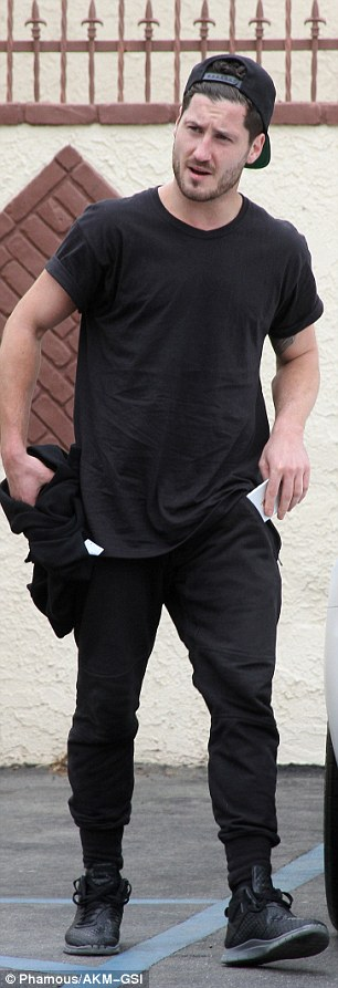 All-black: Rumer's dance partnerVal Chmerkovskiy changed into casual clothes before leaving the studios