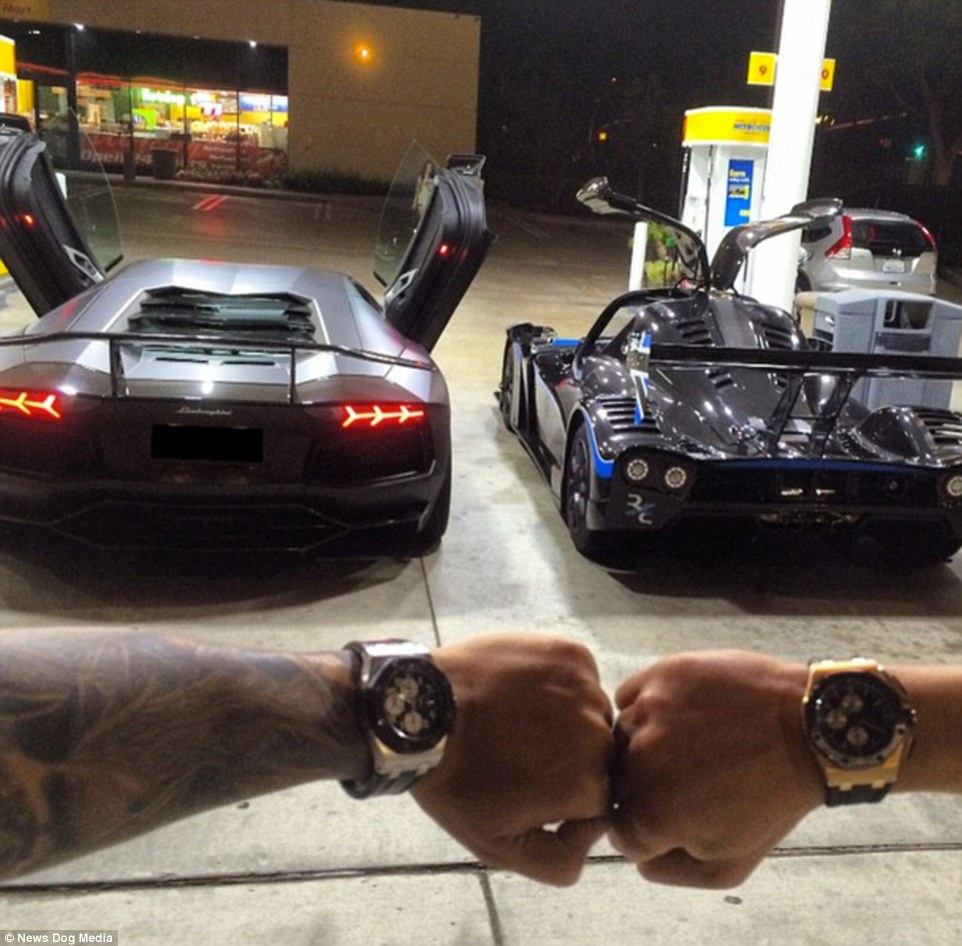 Filling up the cars: Toutouni and a friend, seen showing off their designer watches, stop at a gas station in their hugely expensive vehicles