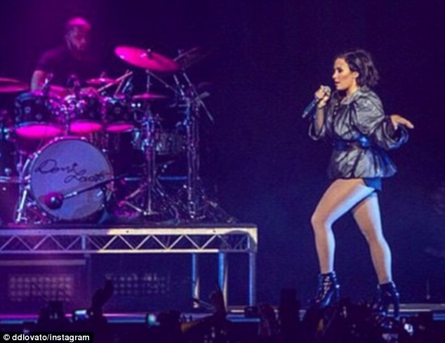 'I miss you already!!': Demi has been trotting the globe for her world tour, which kicked off in 2014 - the singer shared this image of her on stage in Melbourne on Sunday