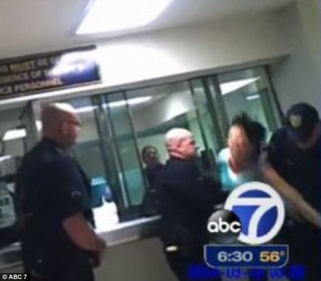 In the right side of the video frame, Sheehan can be seen being grabbed by two officers who take her to the ground. She then loses consciousness and police call for medical assistance