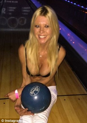 'Inappropriate': The legal case against Kaufman describes a company-funded bowling event from which Tara Reid, pictured, posted raunchy photos online