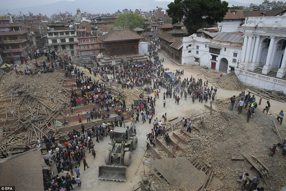 Rescue teams and tractors clear the rubble of collapsed buildings, crumbled temples and broken walls in the famous square yesterday