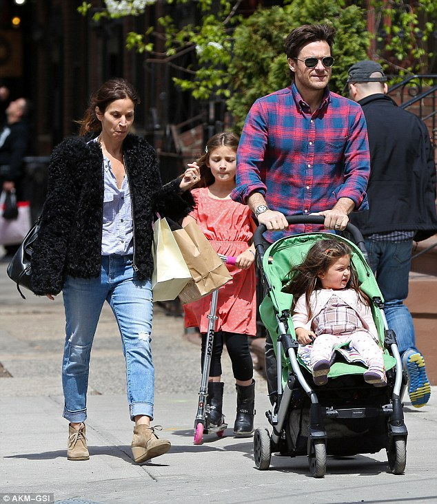 Showing off his domesticated side: Jason Bateman revelled in daddy duty in New York City on Sunday