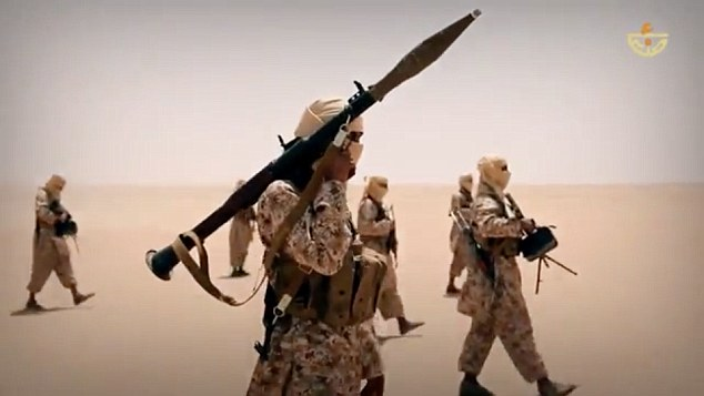 Heavily armed: The fighters in the video can be seen carrying AK-47s, machine guns and a grenade launcher