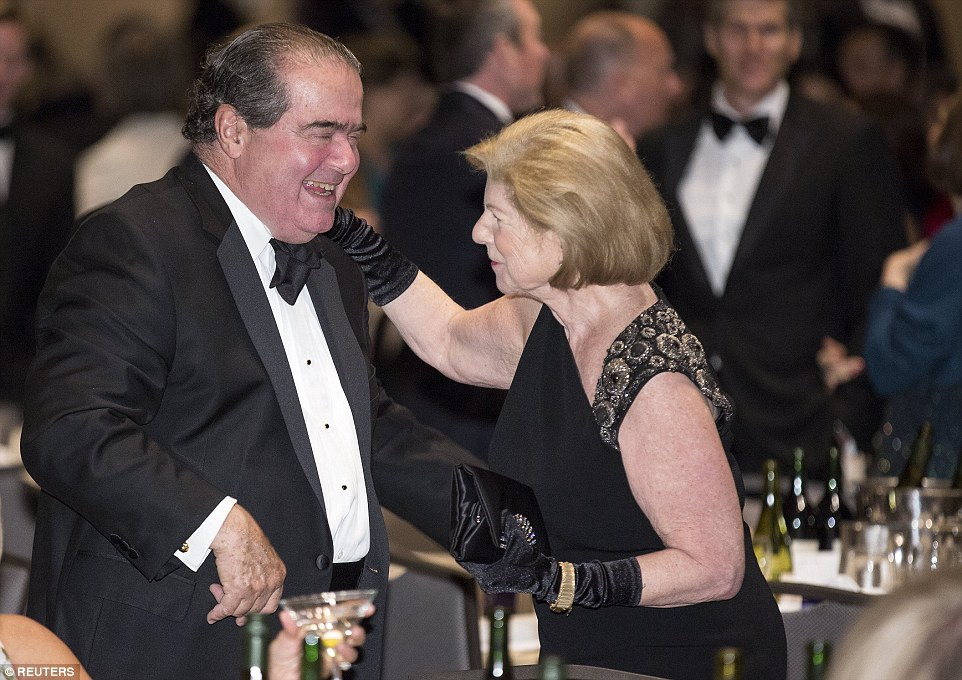 Friends; After planting a kiss on his cheek, Totenberg, donning a black dress and matching gloves, was seen greeting an amused Scalia