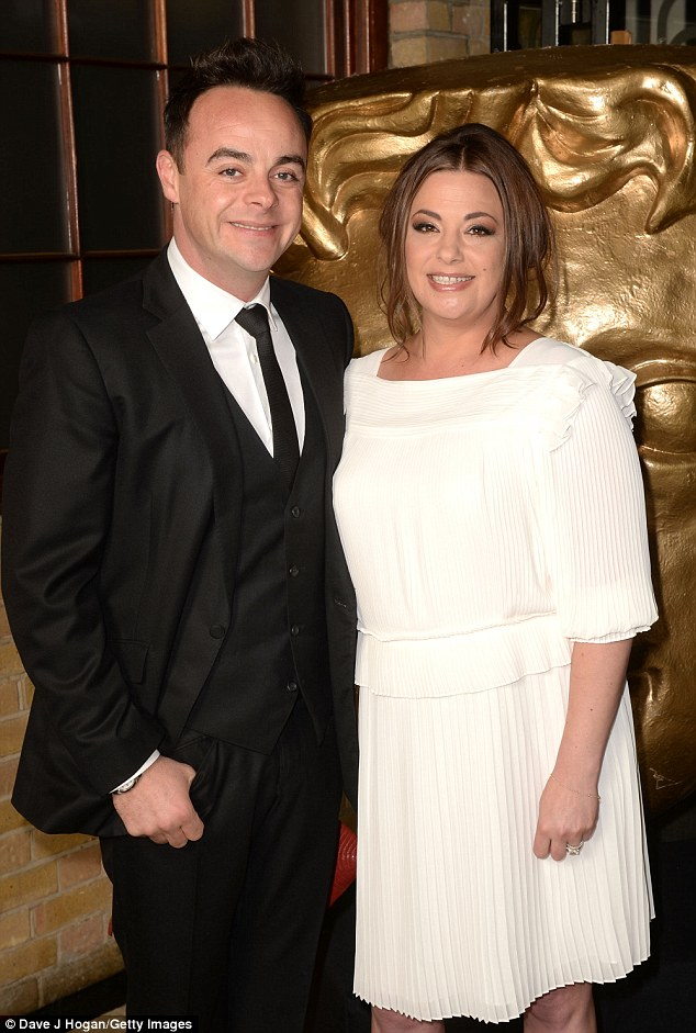 Cute couple: Lisa complemented her man perfectly in a cream dress next to his dark suit