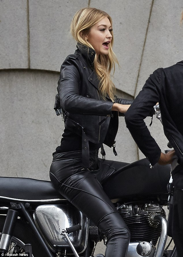 Going hell for leather: She rocked an edgy leather jacket with sleek matching trousers that highlighted her long legs to perfection, adding some contrast with a pair of glossy bubble-gum pink pumps