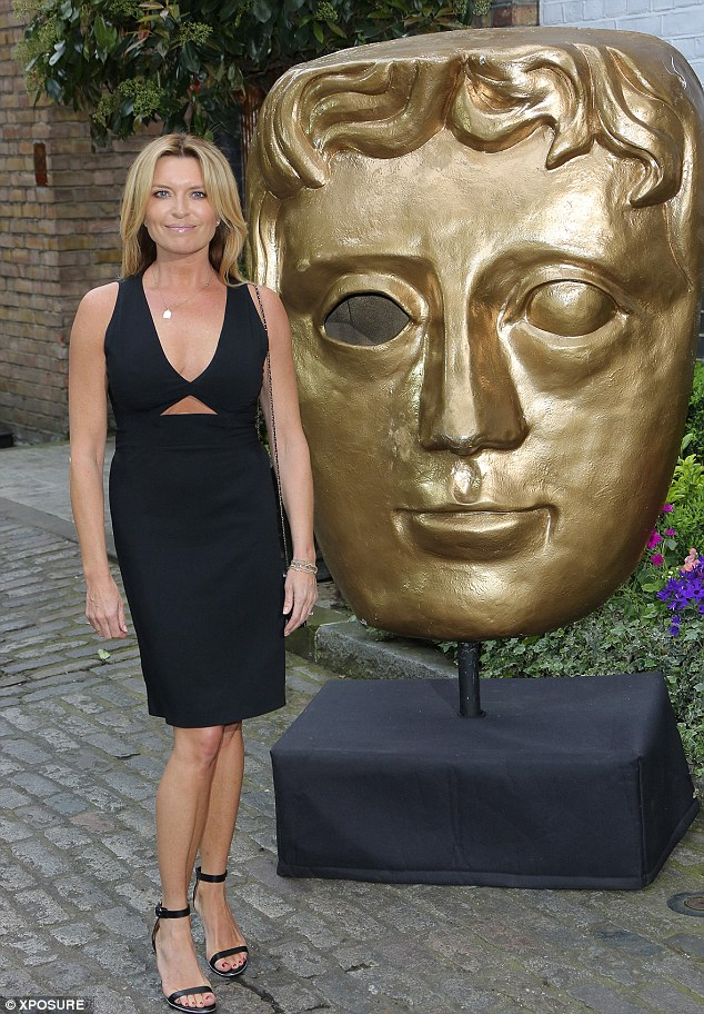 Pitch-perfect: The mother-of-three cut a stylish figure in a daring - but classy - little black dress, which featured a cut-out panel across the chest