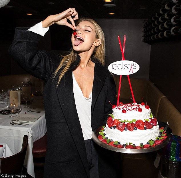 With a cherry on top... She playfully lowered one of the cake's cherries into her mouth