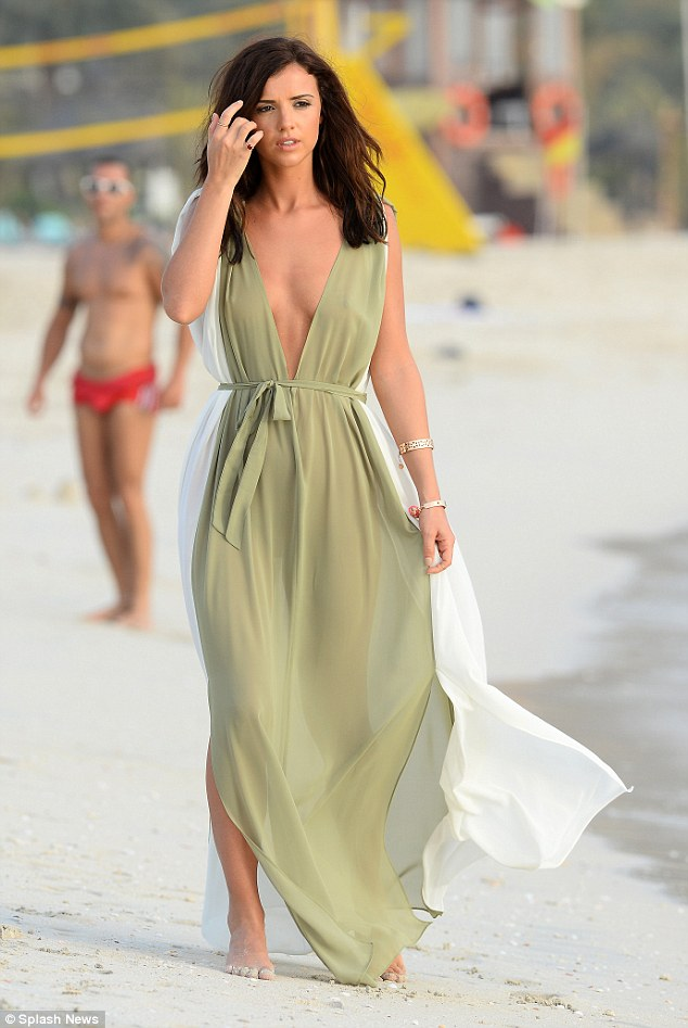 Beach beauty: Lucy looked sensational as she hit the beach in a sheer green kaftan which left little to the imagination