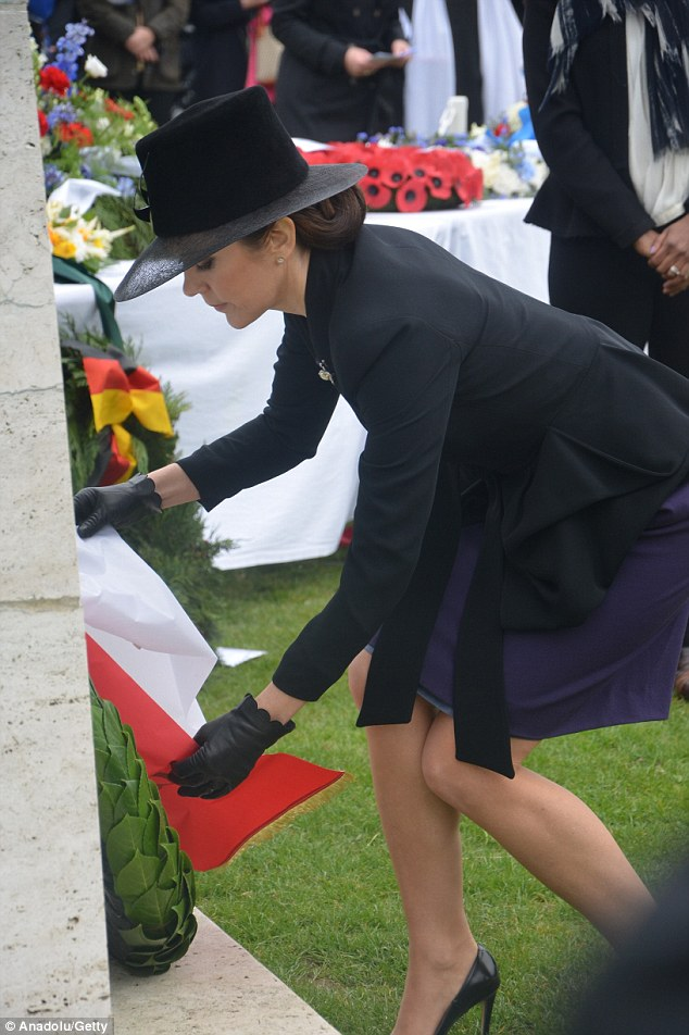 Paying respects: The 43-year-old placed a wreath at a memorial
