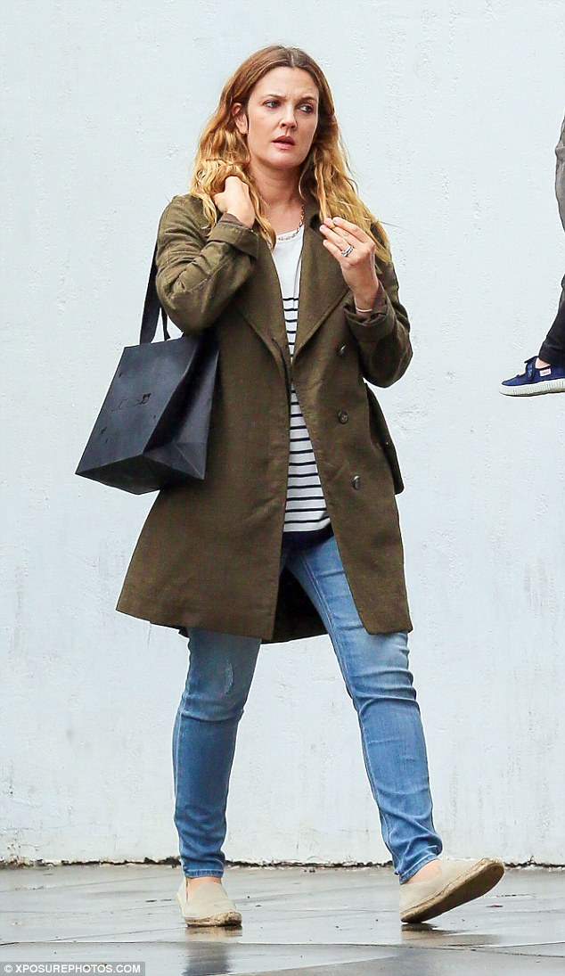 Understated look: The 40-year-old actress looked chic as ever in her skinny jeans, breton top and khaki coat