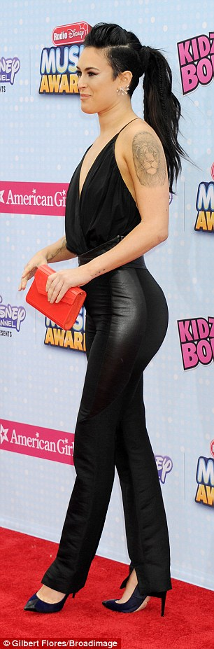 Back in black: The only splash of colour the 26-year-old opted for was a little red clutch purse