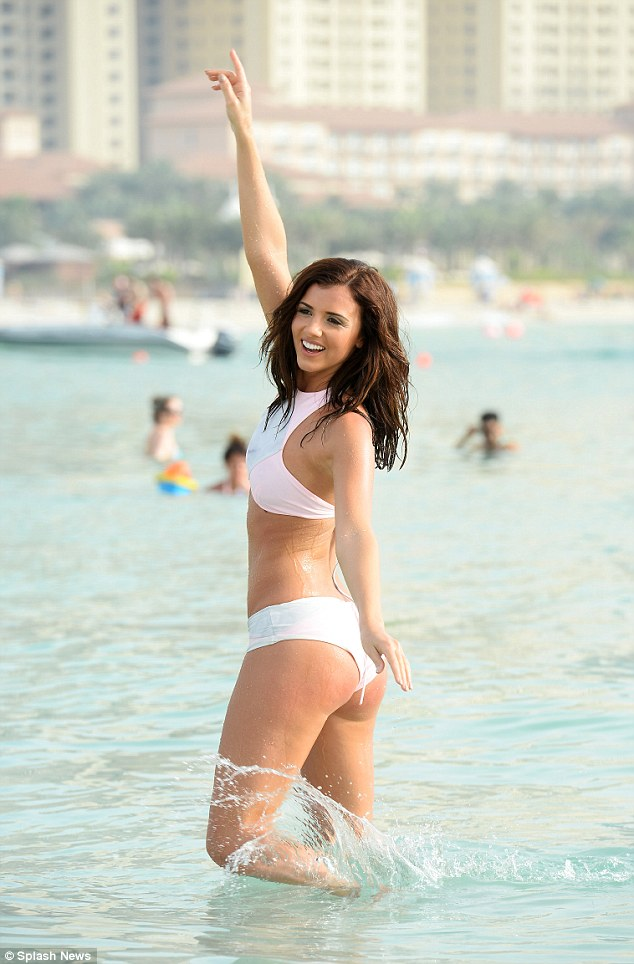 Looking good from every angle: Mecklenburgh also showed off her pert posterior in a white two-piece as she frolicked in the water