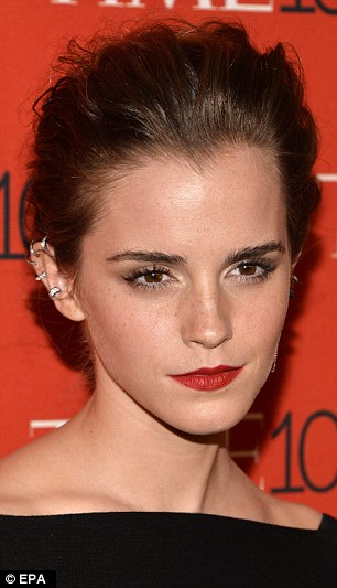 Former Harry Potter star Emma Watson works her magic with diamond cuffs from Repossi (about £8,000)