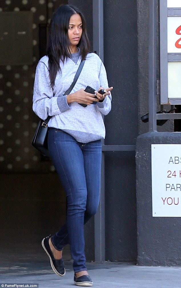 Dressed down: Zoe Saldana went makeup-free and dressed in super casual clothes for errands in Hollywood on Sunday