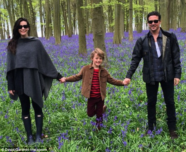 His snap shows the trio holding hands as they pose in the midst of picturesque bluebells and he captioned it: 'Blue Bell Woods !!!! Beautiful weekend @misslivalittle x'