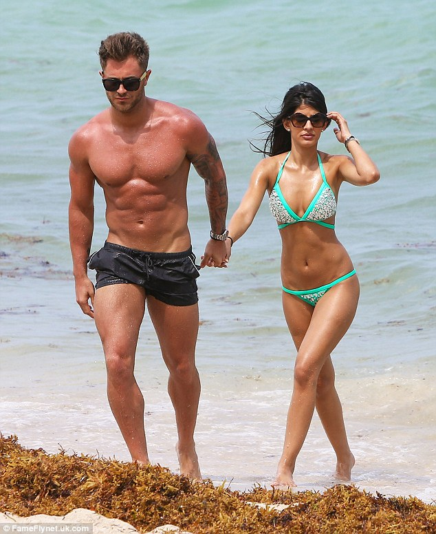 Hand-in-hand: The couple spent the whole day at the beach showing their affection for one another