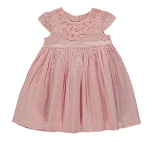 The collection includes an embroidered dress, lace collar gown, sateen romper, lace trim socks and bow ballet shoes in traditional whites and creams as well as baby blues and pinks