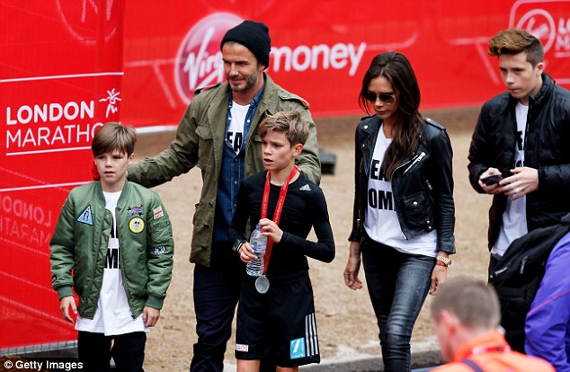The Beckham family pictured at the finish line after Romeo completed the three-mile mini-marathon