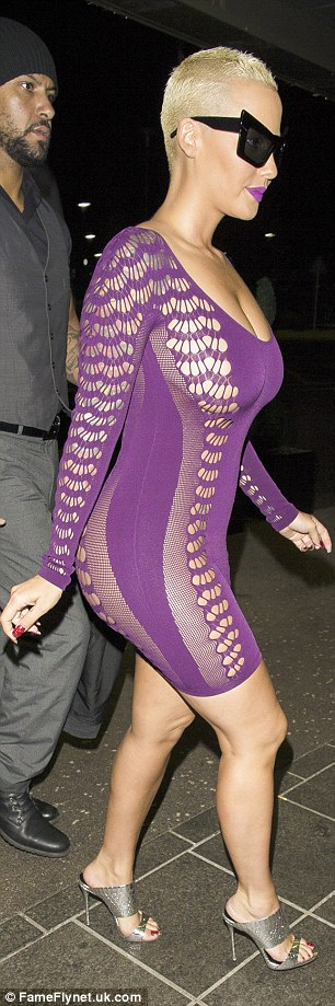 Peek-a-boo: Amber's lack of underwear was on show in the dress which featured mesh panels