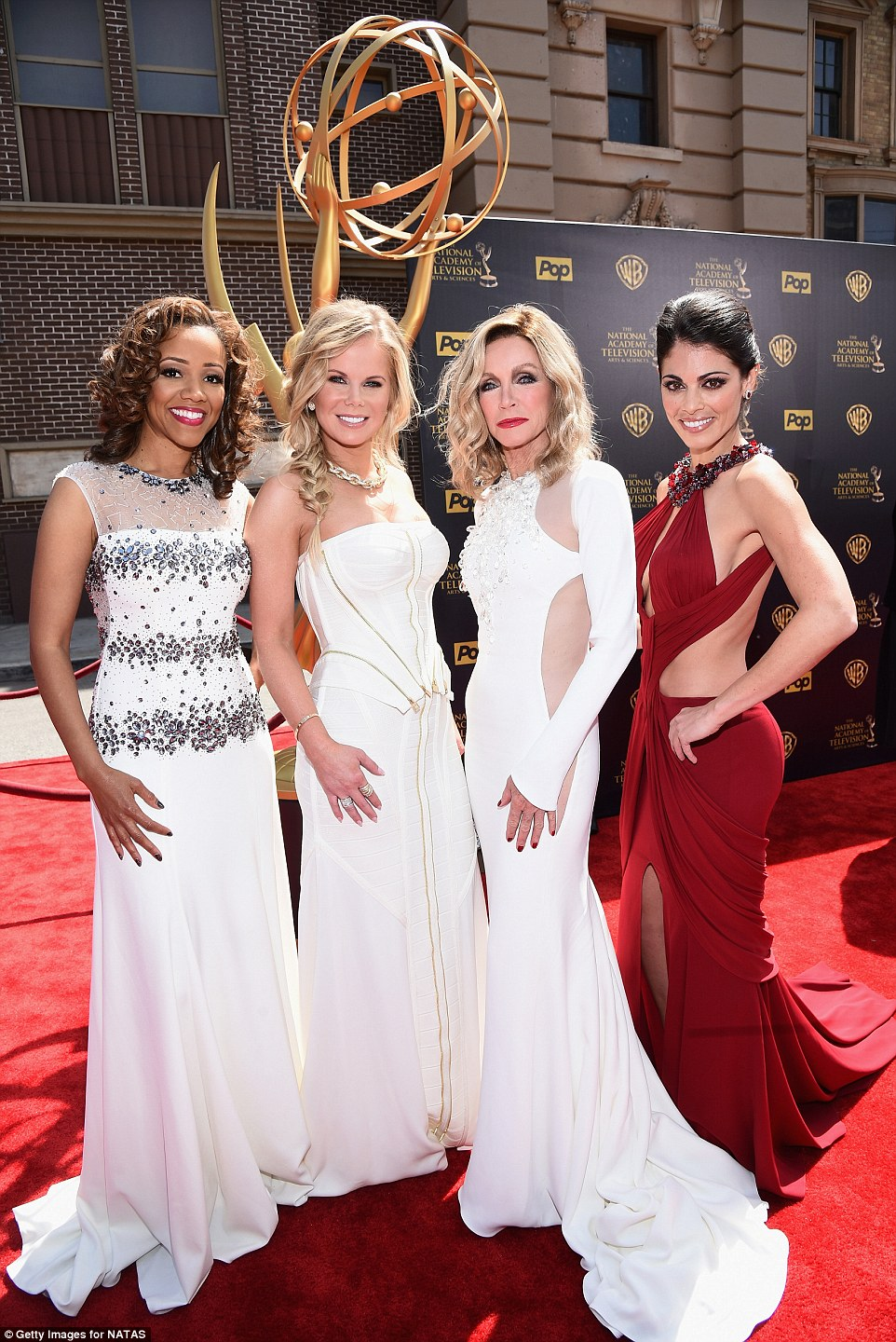 Stylish soap stars: Chrystee Pharris, Crystal Hunt, Donna Mills and Lindsay Hartley (pictured from left to right) all showed of their ensembles as they posed on the red carpet together