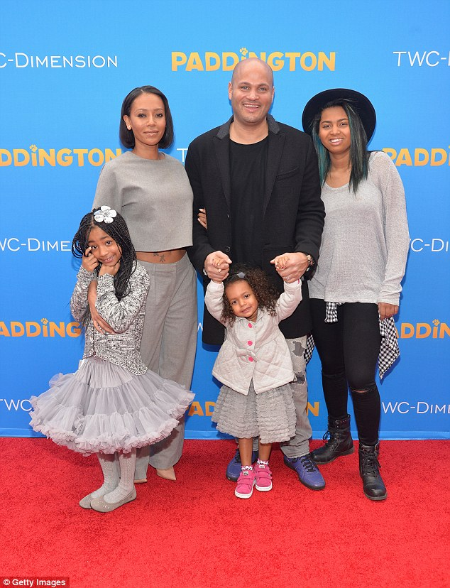 Reconciled: The married couple of eight years seem to be happier than ever with their daughter Madison (cnetre) and her children Phoenix (right) and Angel (left) from two other relationships